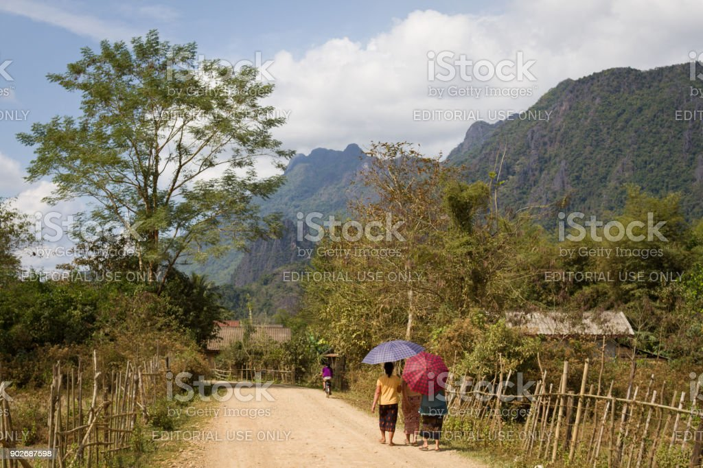 A walk in the sun in Vang Vieng, Laos stock photo
