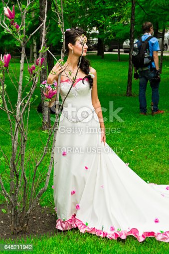 DONETSK, UKRAINE - MAY 15: Walk of brides. Brides pose for the cameras. May 15, 2011 in Donetsk, Ukraine