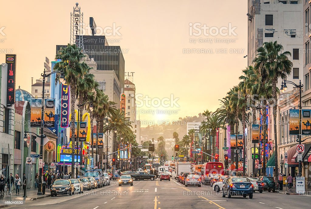 Walk of fame - Hollywood Boulevard in Los Angeles Los Angeles, United States - December 18, 2013: View of Hollywood Boulevard at sunset. In 1958, the Walk of Fame was created on this street as a tribute to artists working in the entertainment industry. 2015 Stock Photo