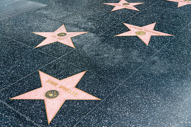 Walk of Fame Hollywood Star - Britney Spears Los Angeles, United States - May 18, 2015: Star of Britney Spears and others at the pavement of the Walk of Fame in Hollywood. The star is reserved for the name of a celebrity from the movie industry. hollywood boulevard stock pictures, royalty-free photos & images