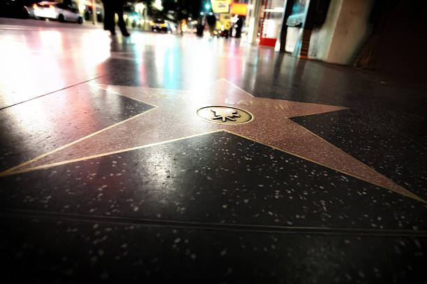 walk of fame Los Angeles, USA - January 21, 2016 - Star at the pavement of the Walk of Fame in Hollywood. The star is reserved for the name of a celebrity. walk of fame stock pictures, royalty-free photos & images