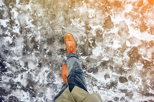 Walk on icy winter pavement background