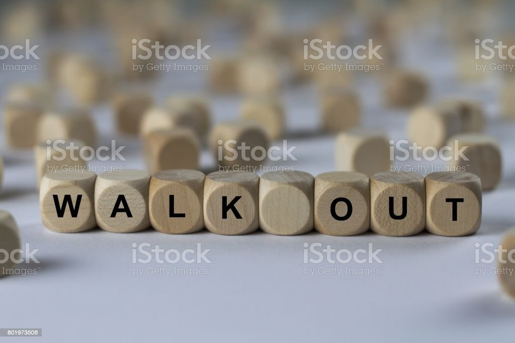walk out - cube with letters, sign with wooden cubes stock photo