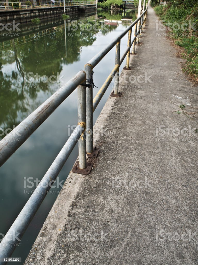 Walk way along the drainage canal stock photo