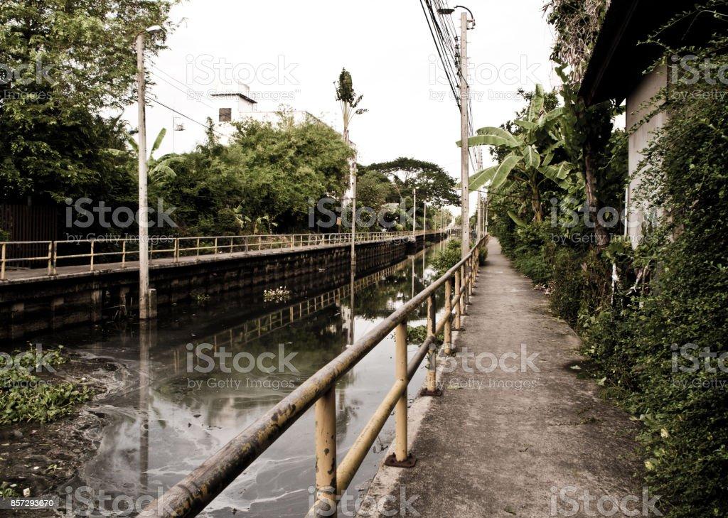 Walk way along the sewage water canal stock photo