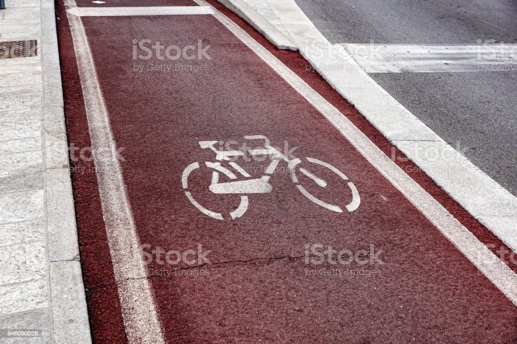Walk way and bicycle lane signs on the asphalt road surface - foto stock