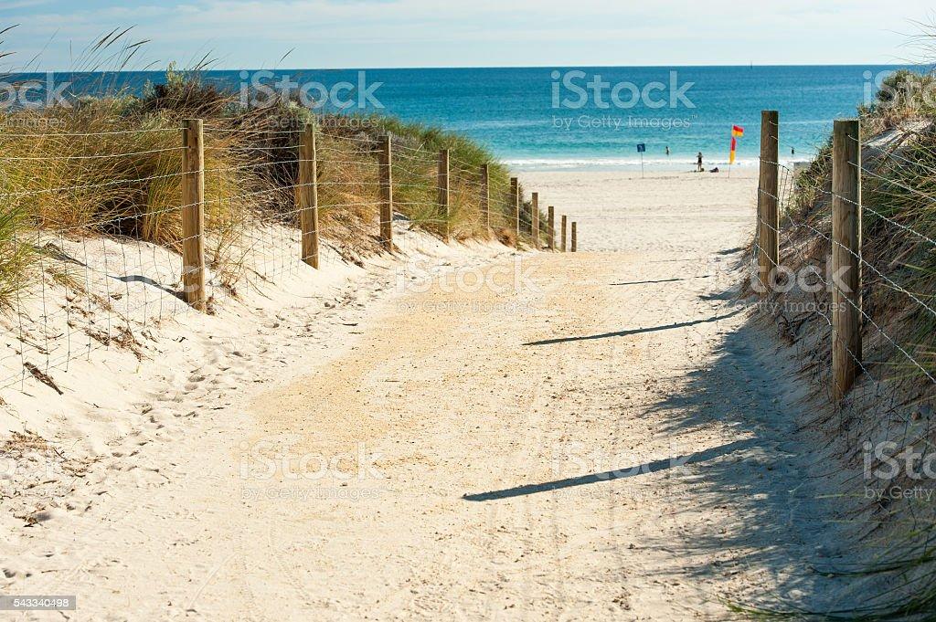 walk way to beach and crystal blue sea stock photo