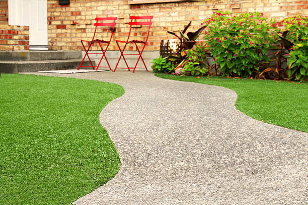 Walk way with perfect grass landscaping with artificial grass in residential area Walk way with perfect grass landscaping with artificial grass in residential area imitation stock pictures, royalty-free photos & images