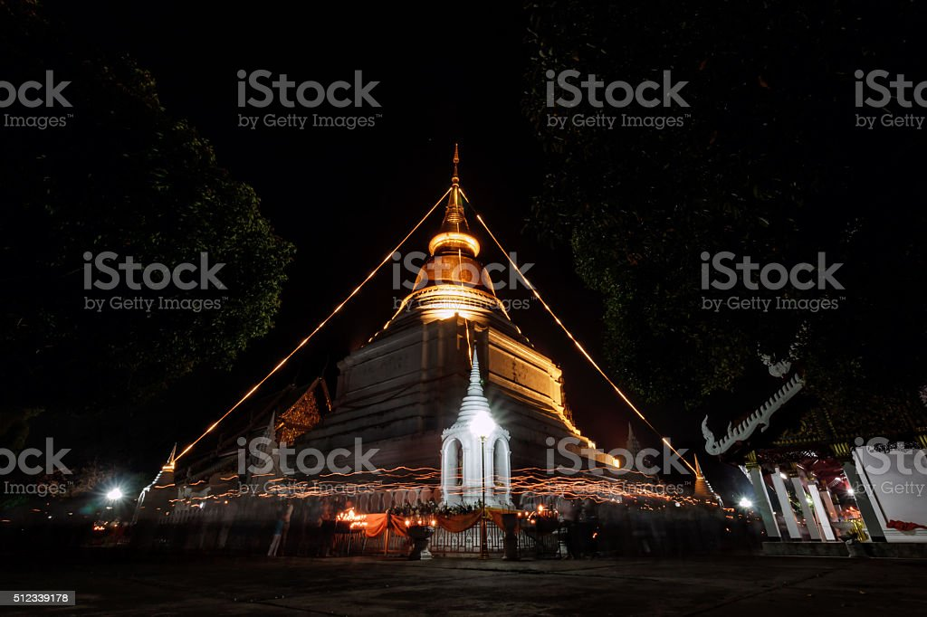 walk with lighted candles in hand around a temple stock photo