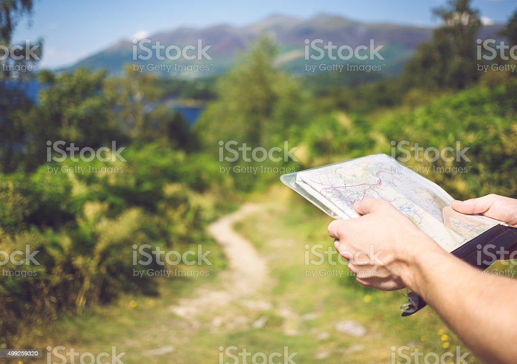 Walker navigating using a map in Cumbria / UK stock photo