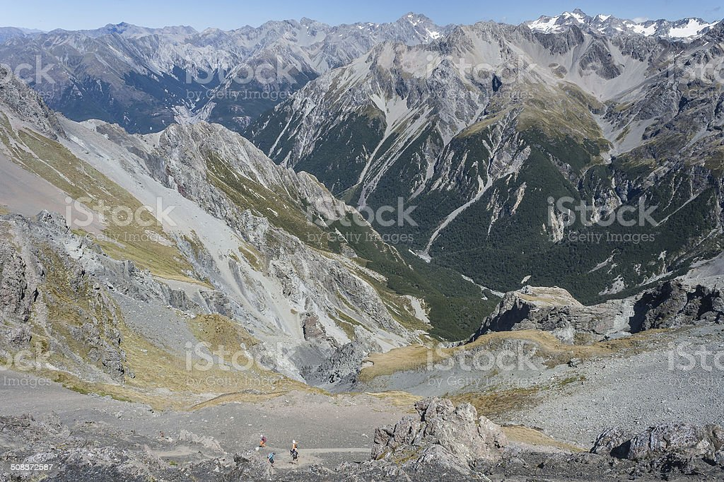 walkers descending to alpine valley in Southern Alps royalty-free stock photo
