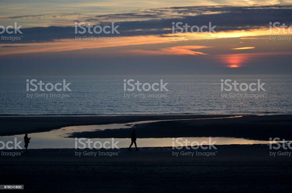 Walkers enjoying a colorfull sunset stock photo