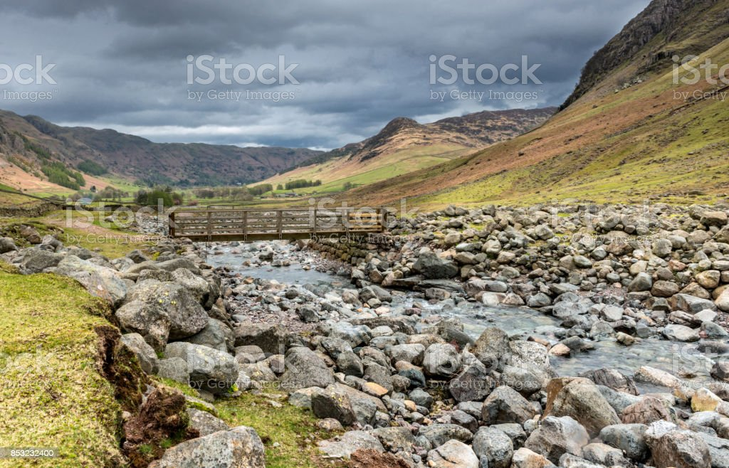 Walkers Footbridge over Lake District River stock photo