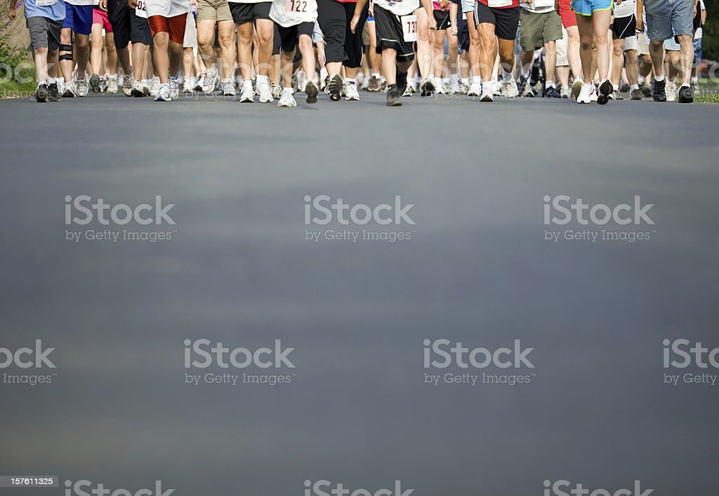 Walker's Legs with Pavement Foreground stock photo