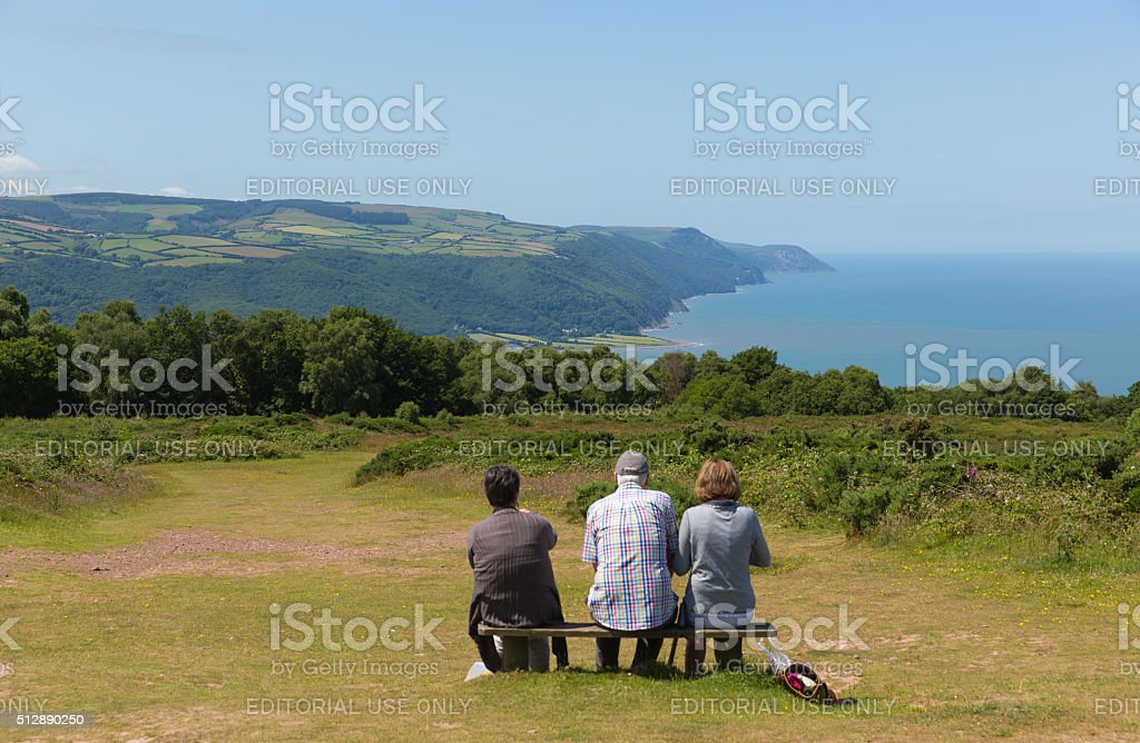 Walkers resting beautiful hot summer weather on Selworthy Beacon Somerset stock photo