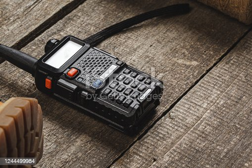 istock Walkie talkie radio set on wooden table close up 1244499984
