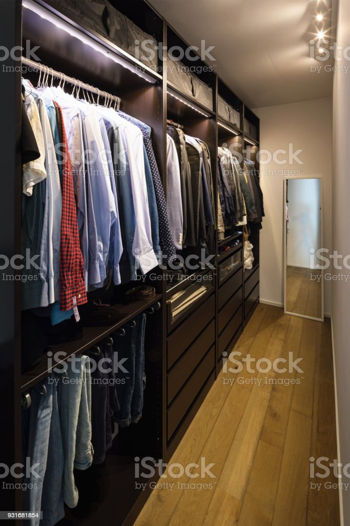 Walk-in closet full of clothes stock photo