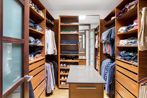 Walk-in Closet with wood paneling. stock photo