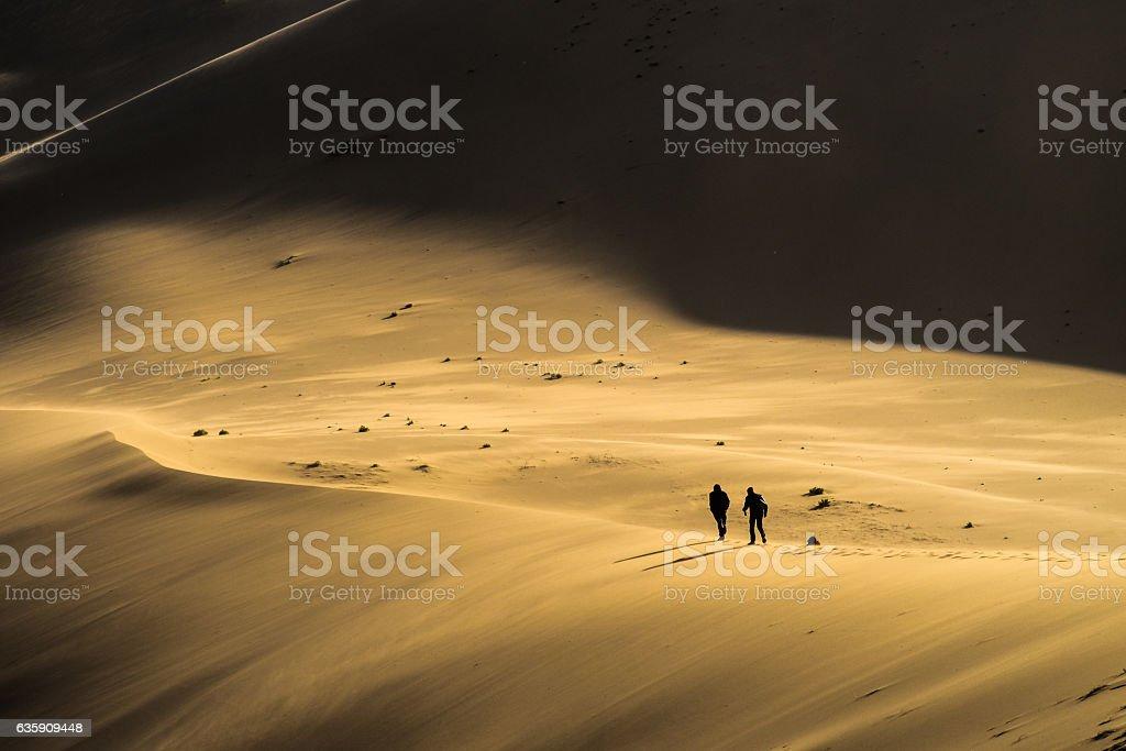 Walking a sand dune stock photo