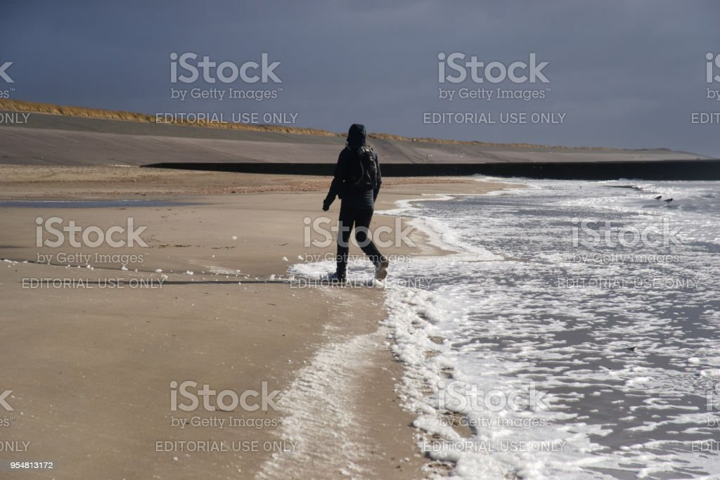 Walking across the beach of northsea island Borkum stock photo