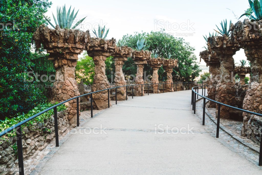 Walking alley with sand culumns in Park Guell, Spain stock photo