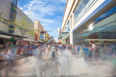 Walking along a shopping street with motion blur