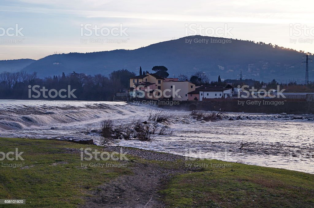 Walking along the Arno river, near Florence, at dawn stock photo