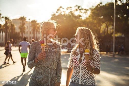 istock Walking and eating ice cream 611870928