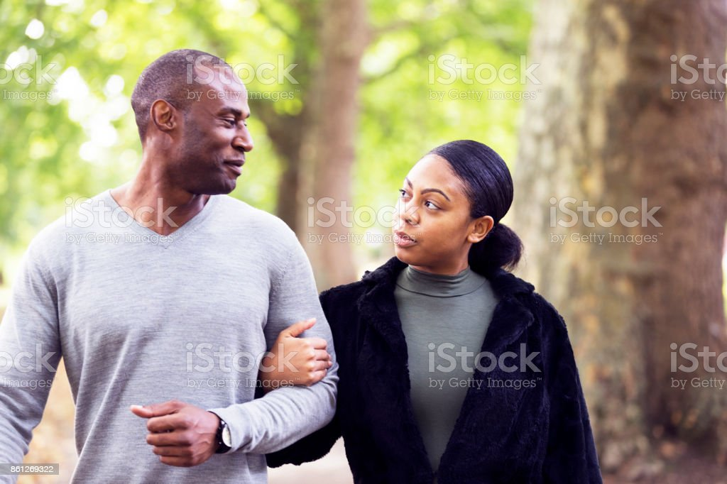 Walking and talking while in the arms of the significant other stock photo