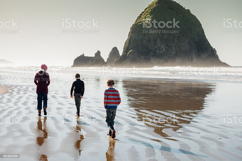 Walking at Cannon Beach stock photo