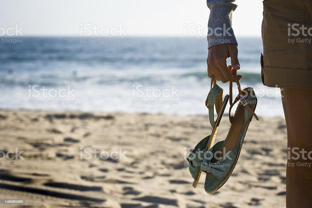 Walking Barefoof On The Beach stock photo