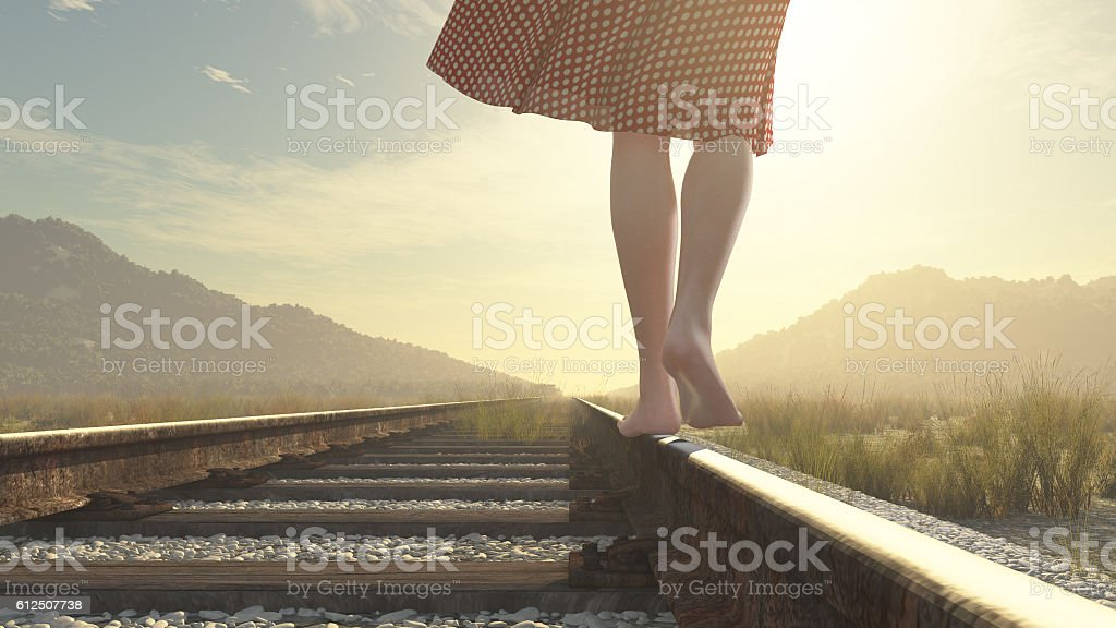 Walking barefoot girl on the railway stock photo