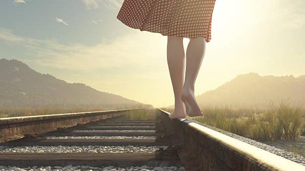 Walking barefoot girl on the railway – Foto
