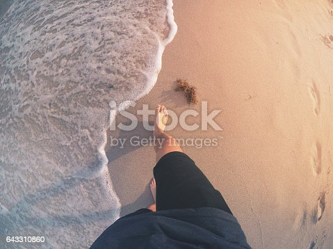 1088451256 istock photo POV: Walking Barefoot on a Beach 643310860
