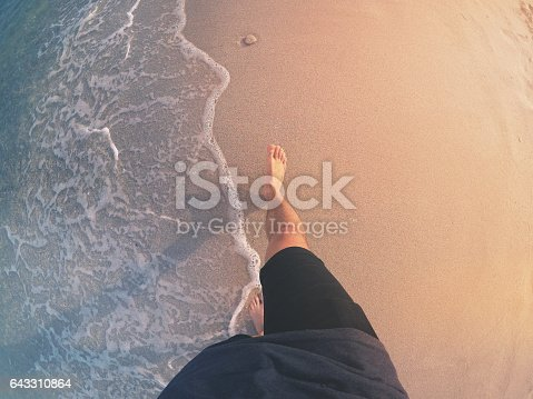 1088451256 istock photo POV: Walking Barefoot on a Beach 643310864