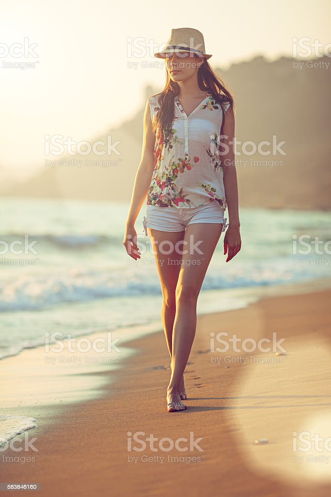 Walking barefoot on the beach stock photo