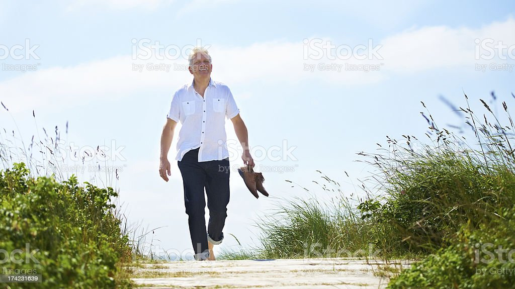Walking barefoot through the park stock photo