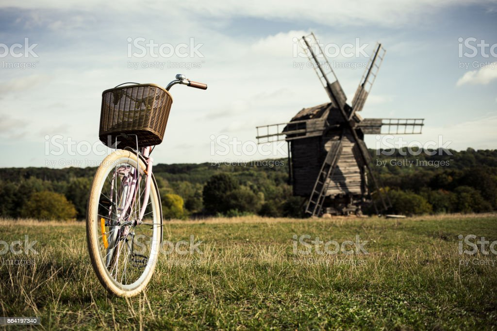walking bike, a sunny day. mill and field royalty-free stock photo