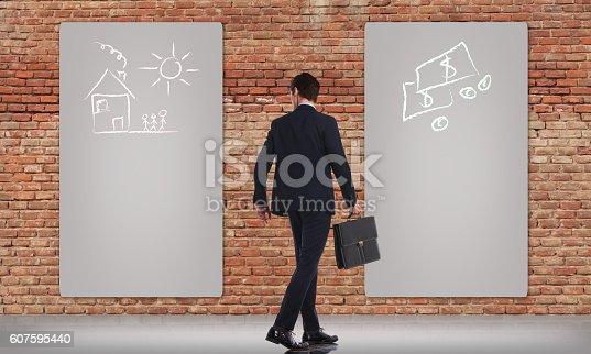 istock walking business man deciding between family or career 607595440