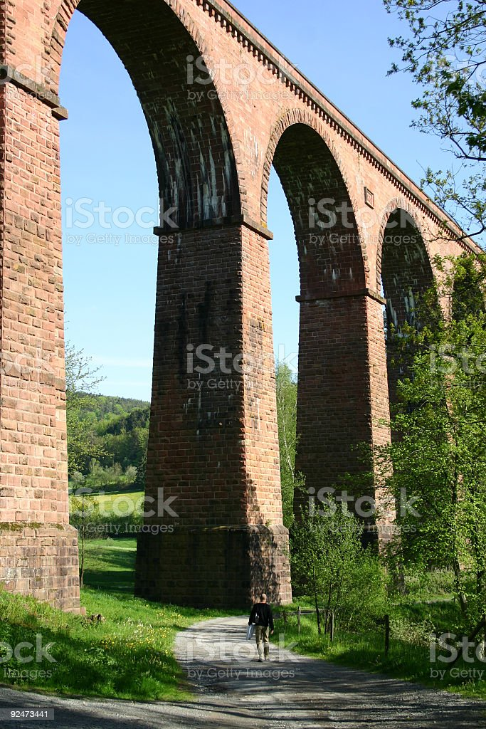 Walking by a railway viaduct royalty-free stock photo