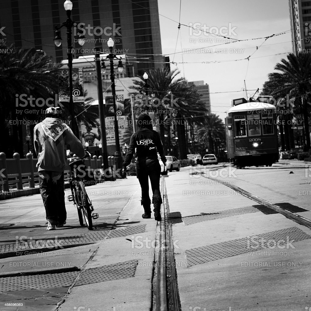 Walking by New Orleans streetcar royalty-free stock photo