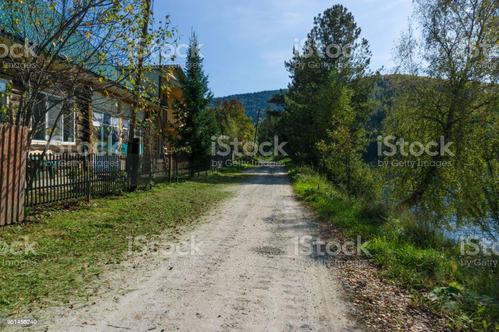 Walking by siberian village stock photo