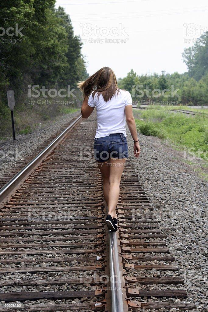 Walking Down the Tracks royalty-free stock photo