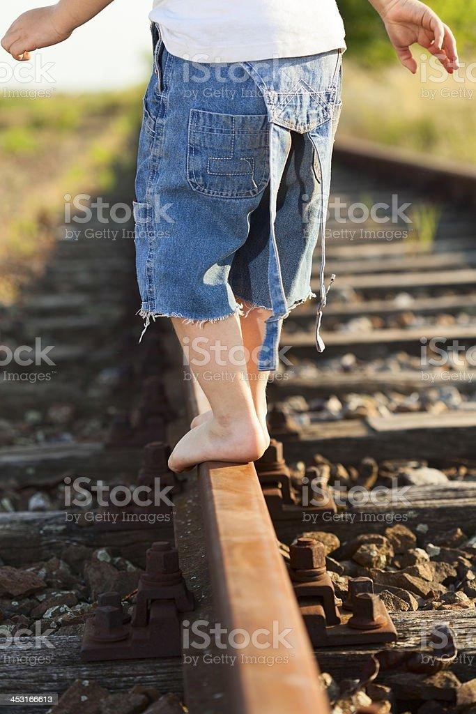 Walking down train tracks royalty-free stock photo