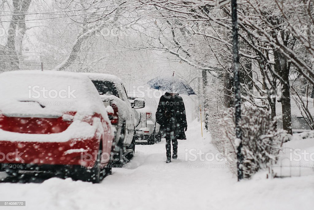 Walking during snow fall stock photo