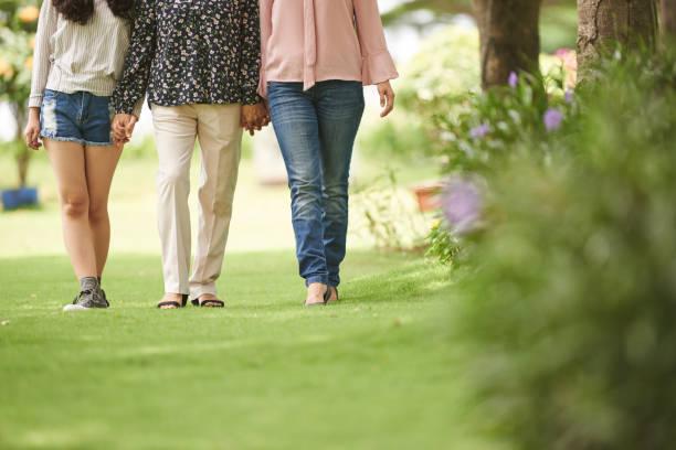 walking familie  - granny legs stock-fotos und bilder