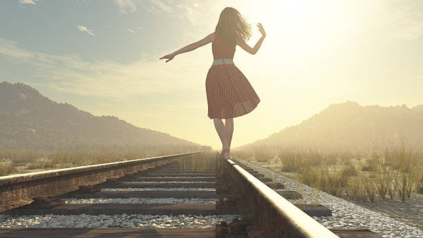 walking girl on the railway - courage stock photos and pictures