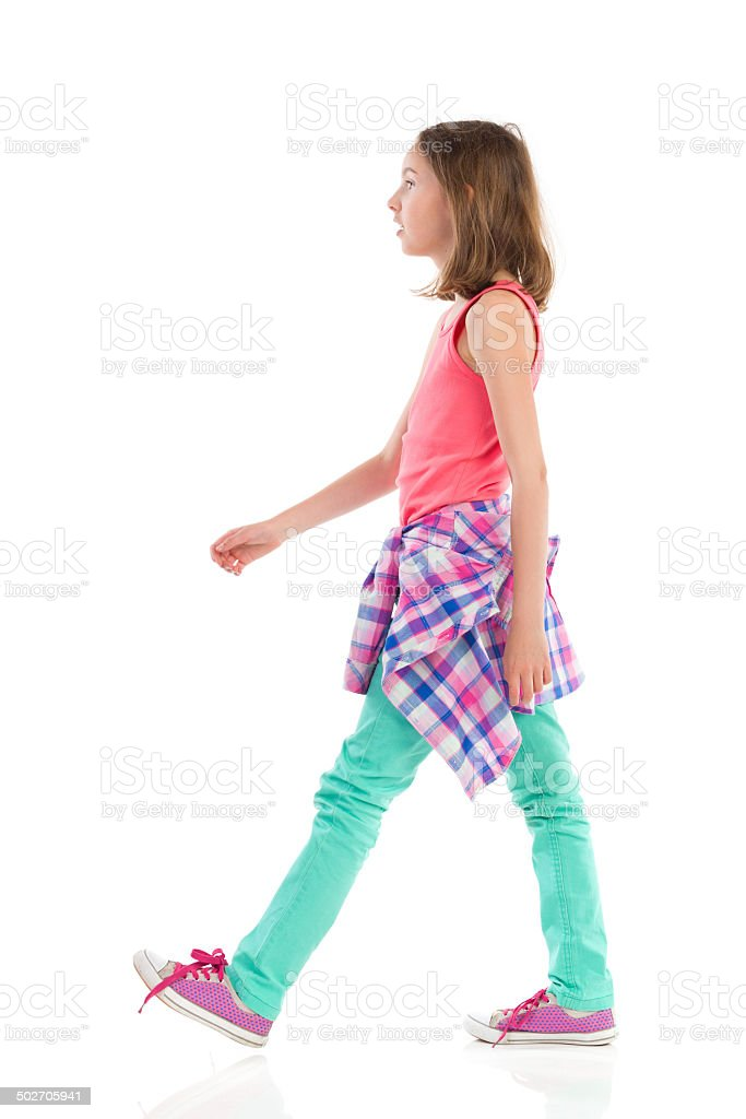 Walking girl, side view. stock photo