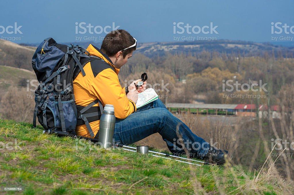 walking hiker looking at map02 stock photo