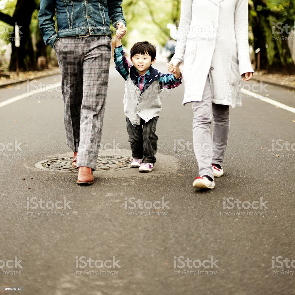 Walking holding hands stock photo